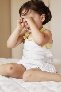 A baby crying because of vaginal yeast infection discomfort