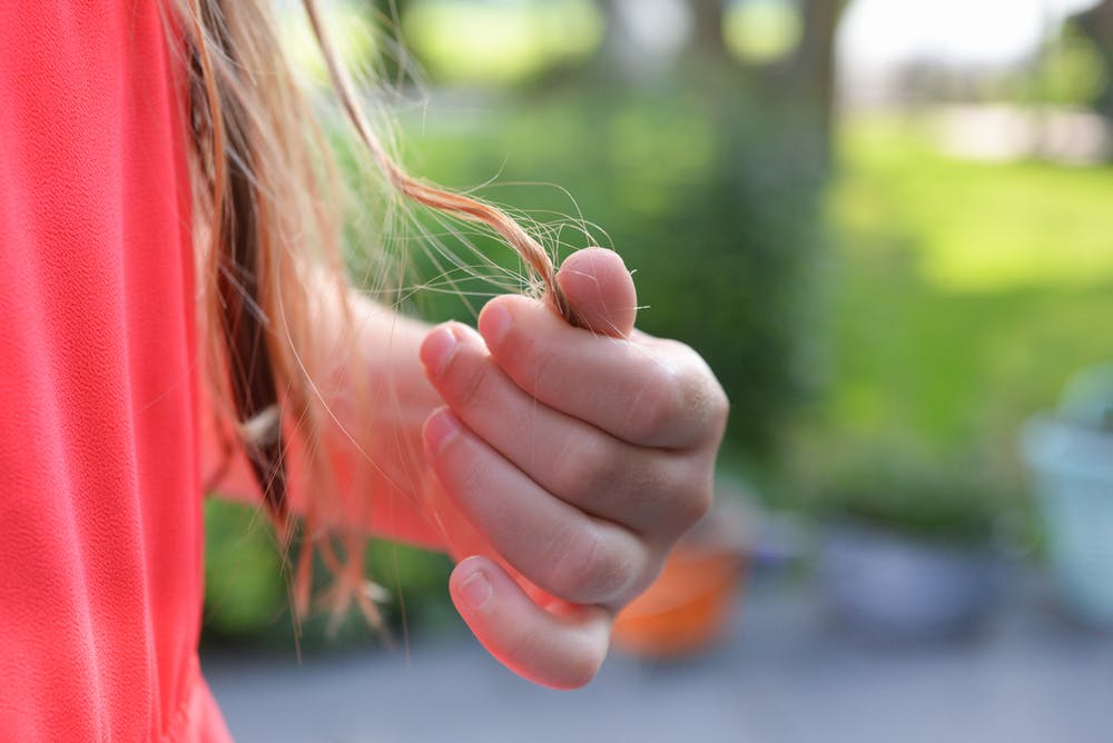 A girl shedding hair